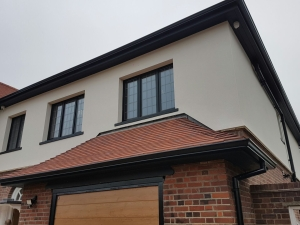 black-continuous-guttering-aluminium-downpipes
